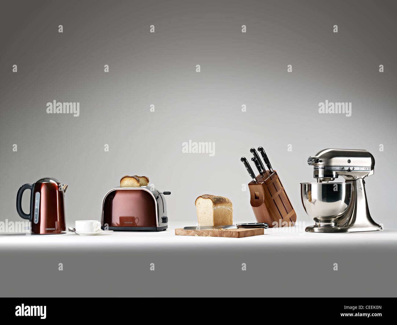 selection of kitchen appliances in a row - Stock Image