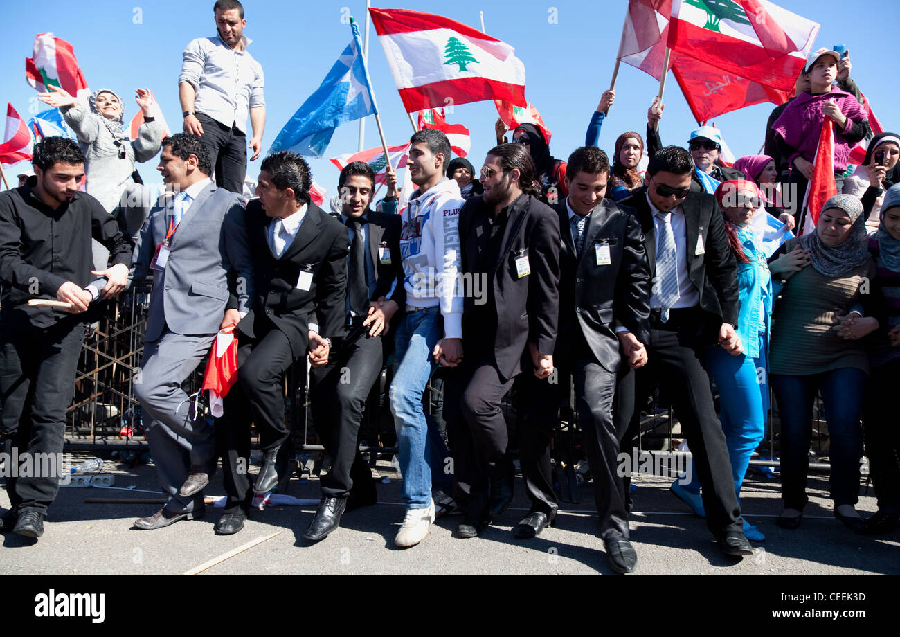 Political officials dance at rally with up to a million people attending, in Martyrs Square, Beirut, Lebanon - Stock Image