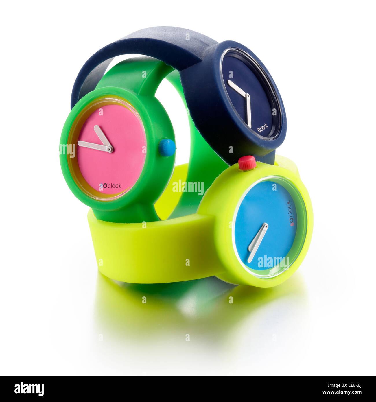 3 plastic bright watches - Stock Image
