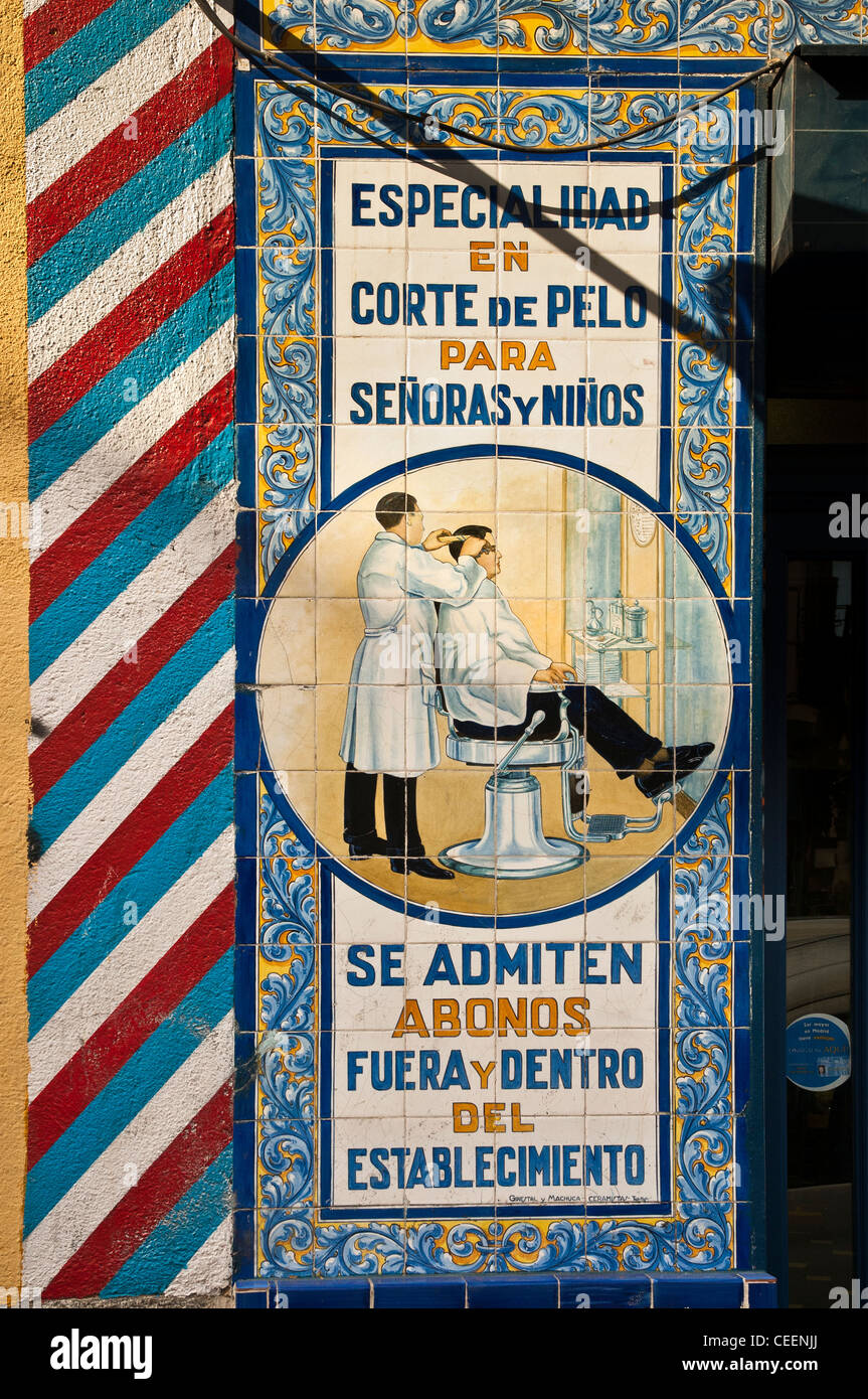 Tiles outside a barbers shop near the Plaza de Anton Martin, Central Madrid, Spain - Stock Image
