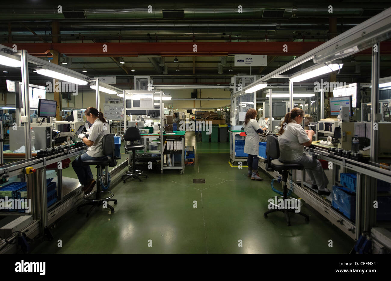 Factory workers at the assembly line - Stock Image