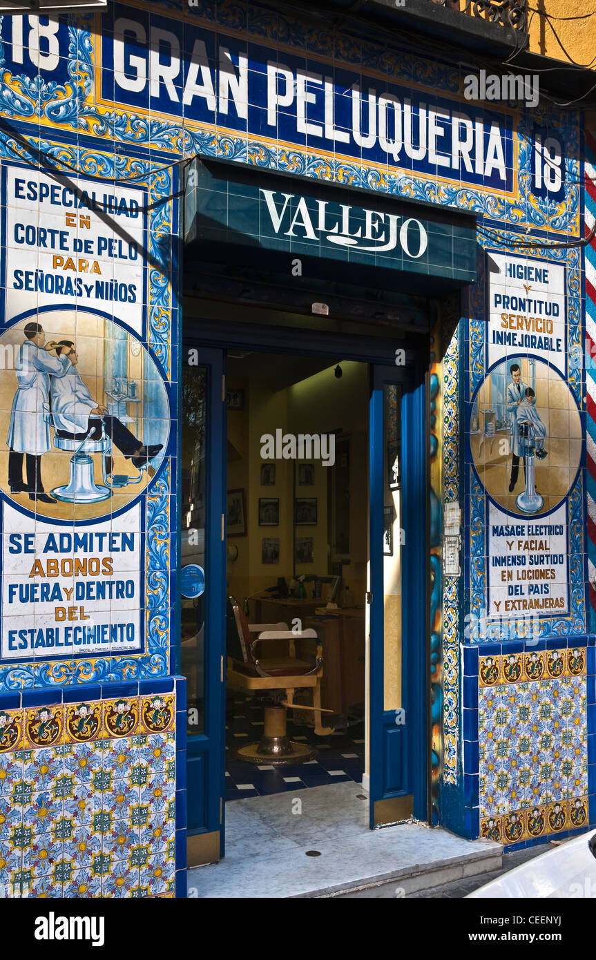 Tiles decorating a barbers shop near the Plaza de Anton Martin, Central Madrid, Spain - Stock Image