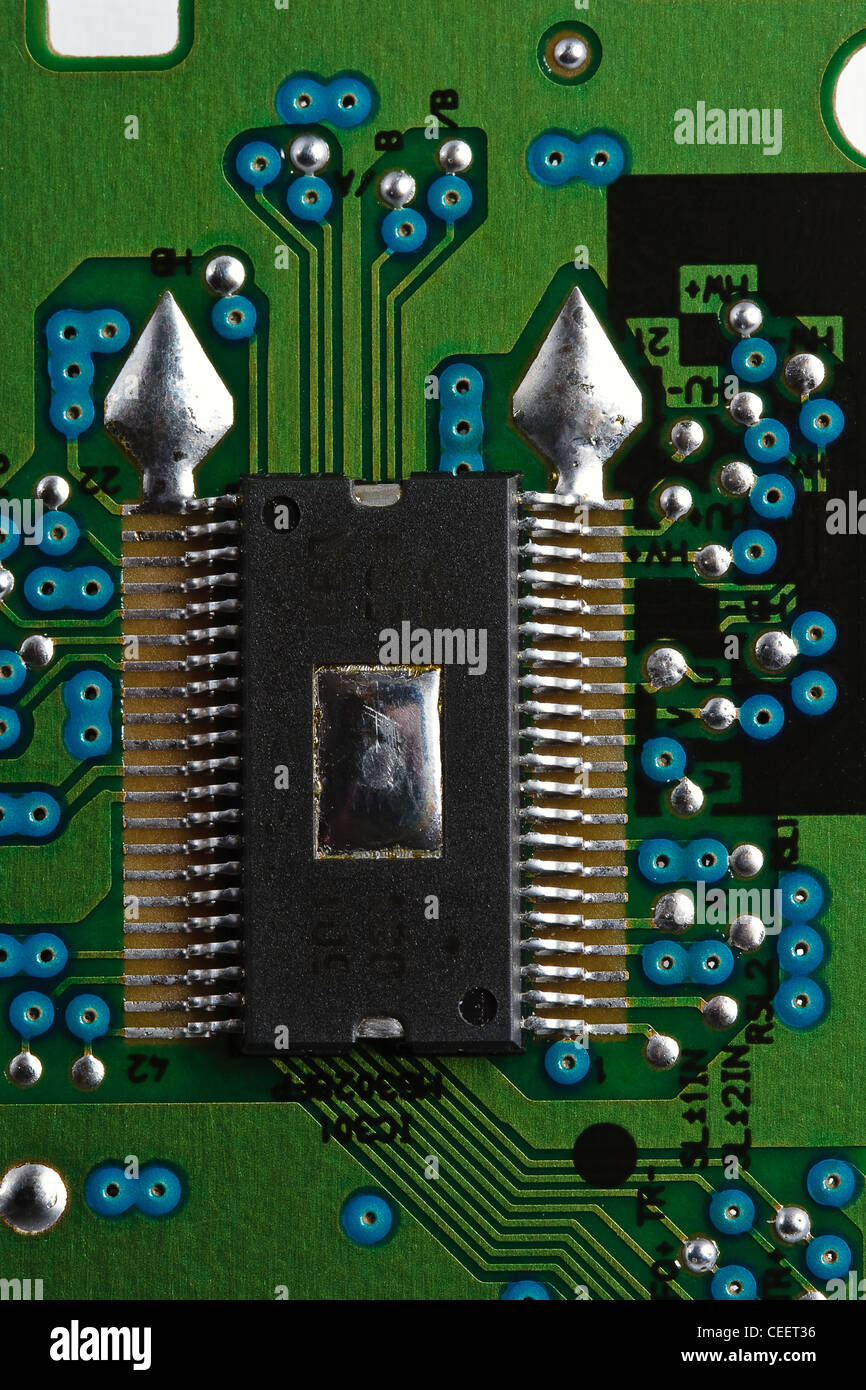 Microchip on green printed circuit board - Stock Image