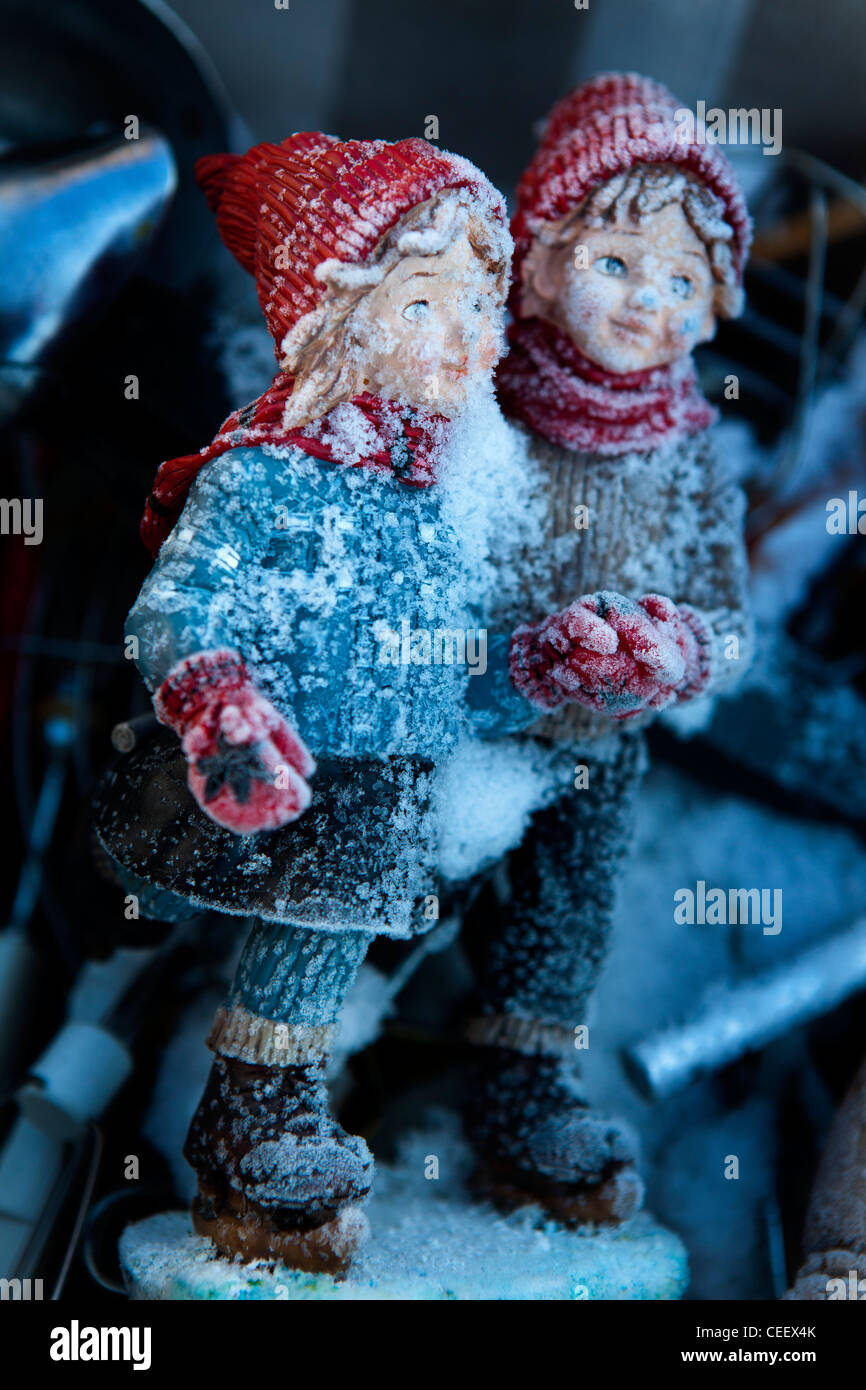 Statuette of ice skaters in the snow, Flea market Kreuzberg Berlin, Germany - Stock Image