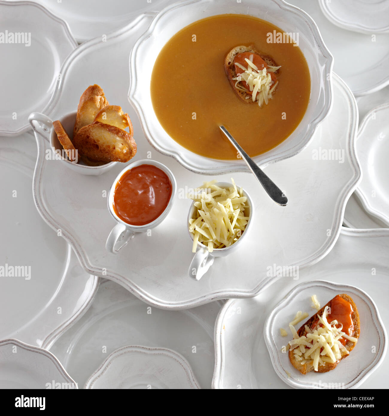 Lobster bisque soup crouton overhead white plates - Stock Image