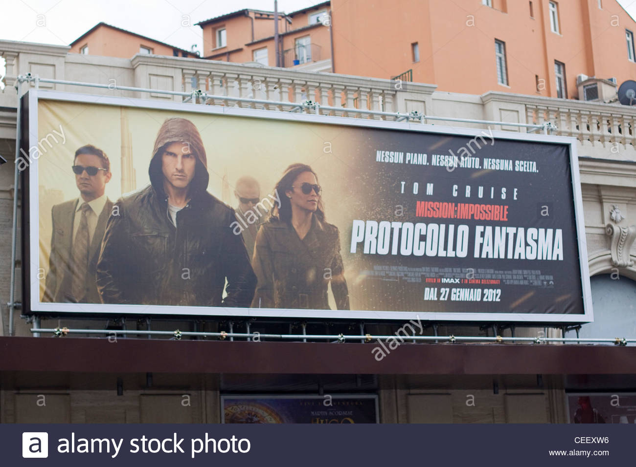 A Poster Advertising Mission: Impossible Ghost Protocol Written in Italian on a street in Rome - Stock Image