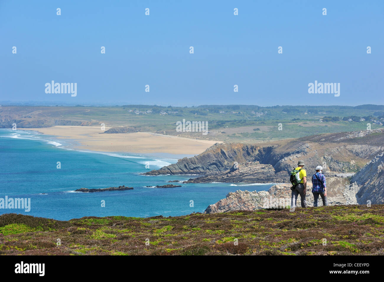 Hikers following long-distance trail along the Cap de la Chèvre, Finistère, Brittany, France - Stock Image