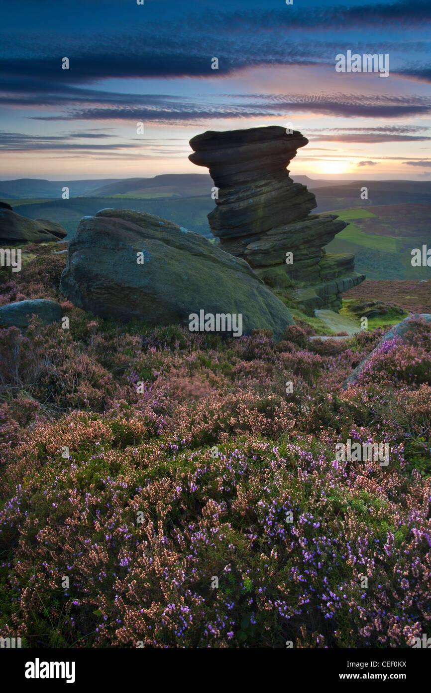 Sunset over The Salt Cellar, a gritstone rock formation on Derwent Edge in The Derbyshire Peak District, UK - Stock Image