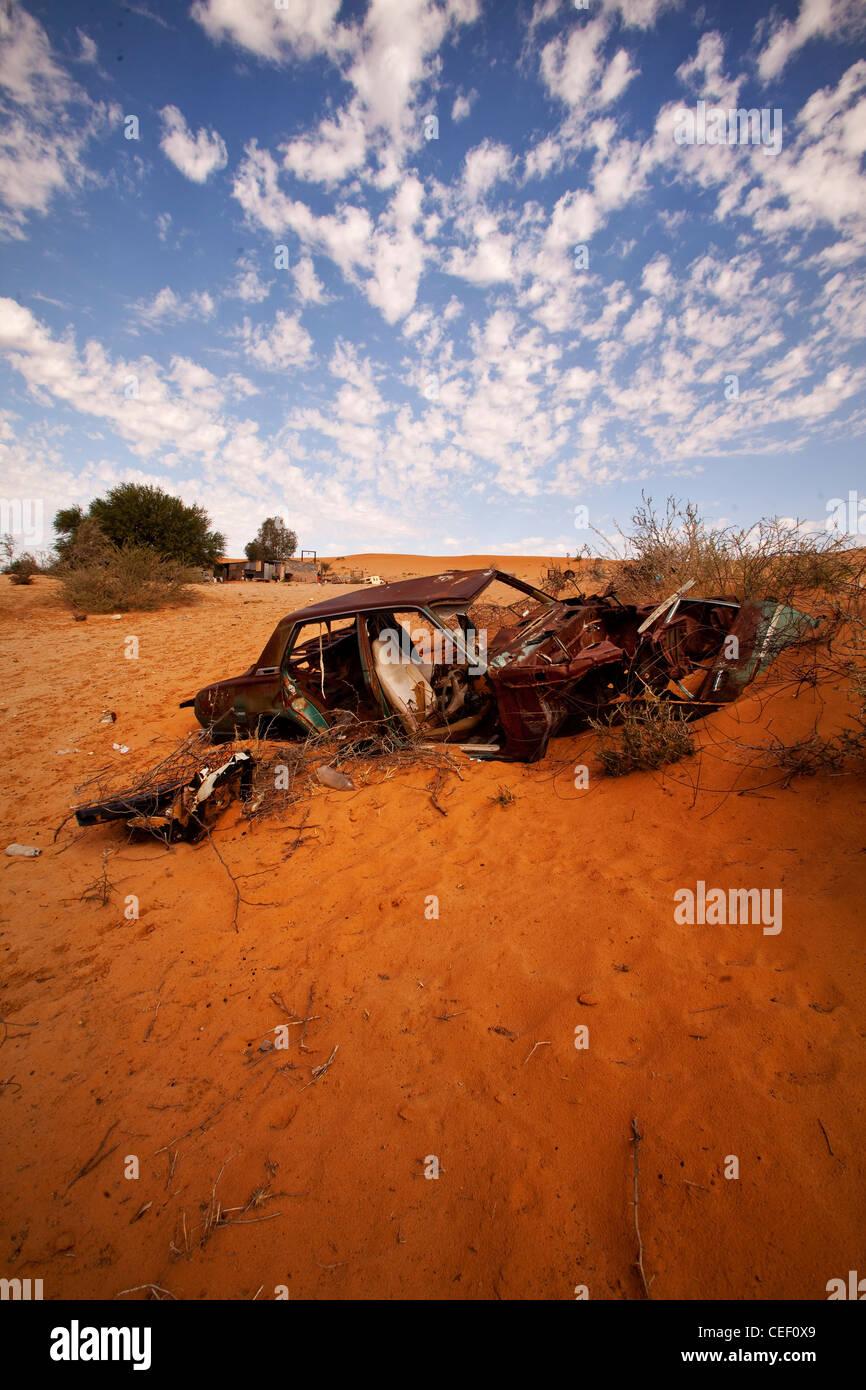 Wrecked car in the Kalahari Desert near the Kgalagadi Transfrontier Park, southern Africa - Stock Image