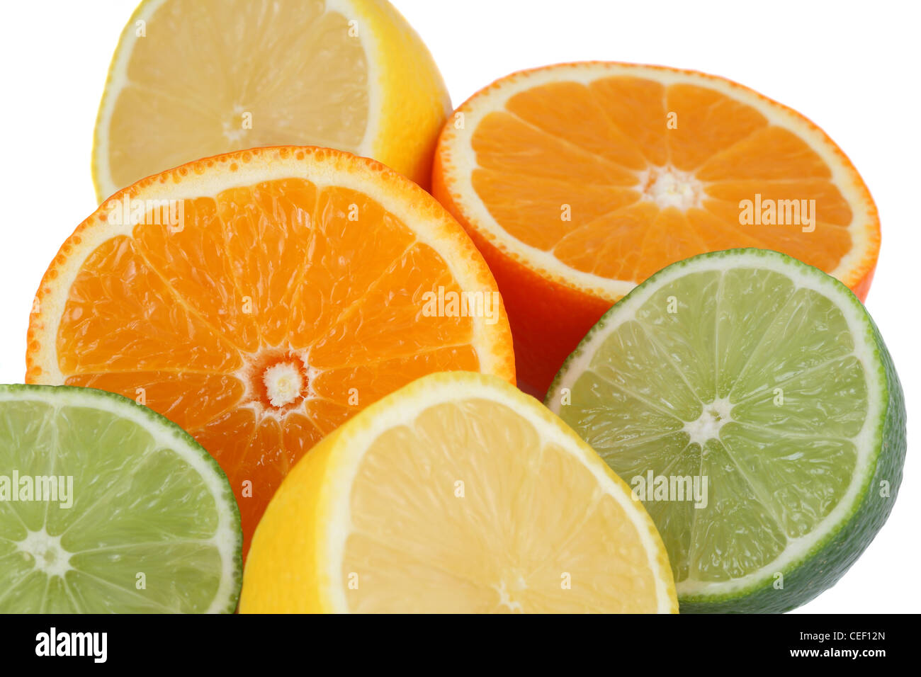 Oranges, lemons, limes, citrus fruits as a background on white - Stock Image