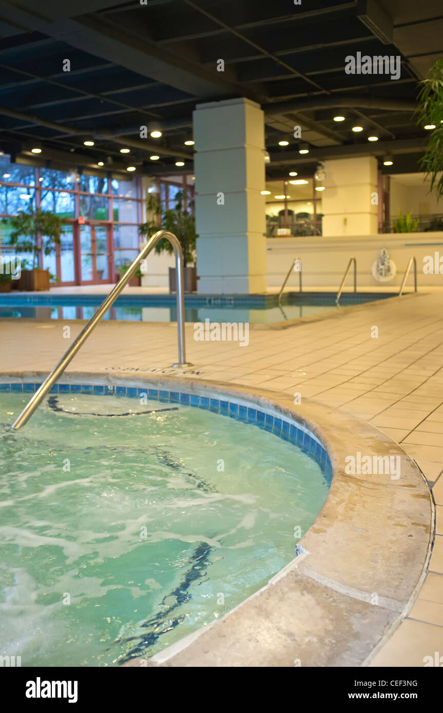 Hot tub and swimming pool in spa and wellness area of a ...