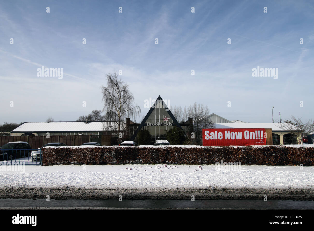Brookfield's Garden Centre as seen from the main road during the snow - sale now on - Stock Image