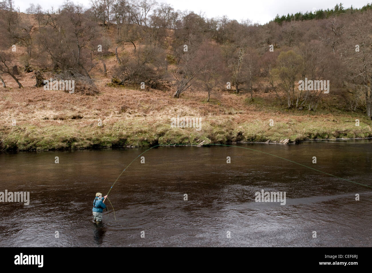 Man Salmon Fishing in the River Oykel, Sutherland, Scotland - Stock Image