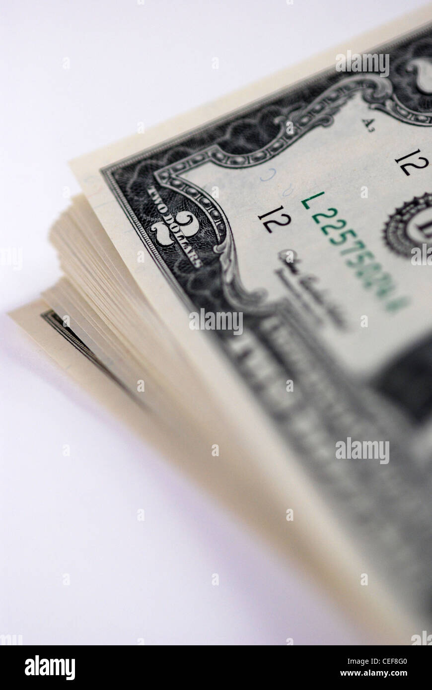 A stack of new USD two dollar bills.  Close up shot on white background.  Shallow depth of field. - Stock Image