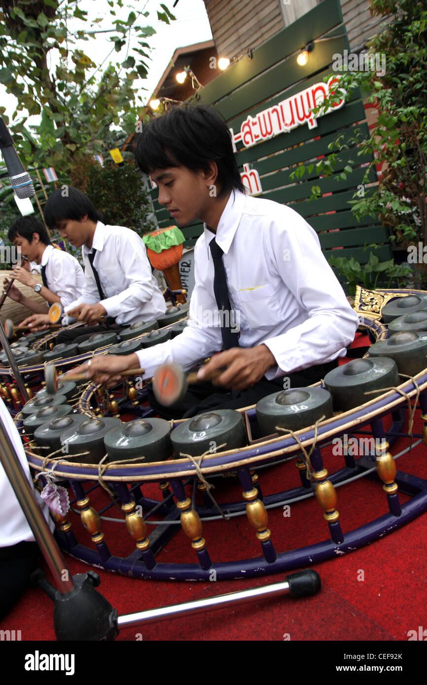 Thai Musician plays Khong wong lek ( Traditional Thai musical instruments ) - Stock Image