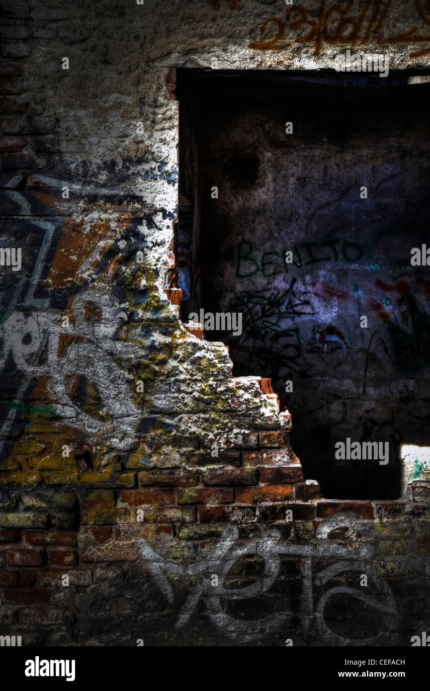 Graffiti in an old abandoned ruins. - Stock Image
