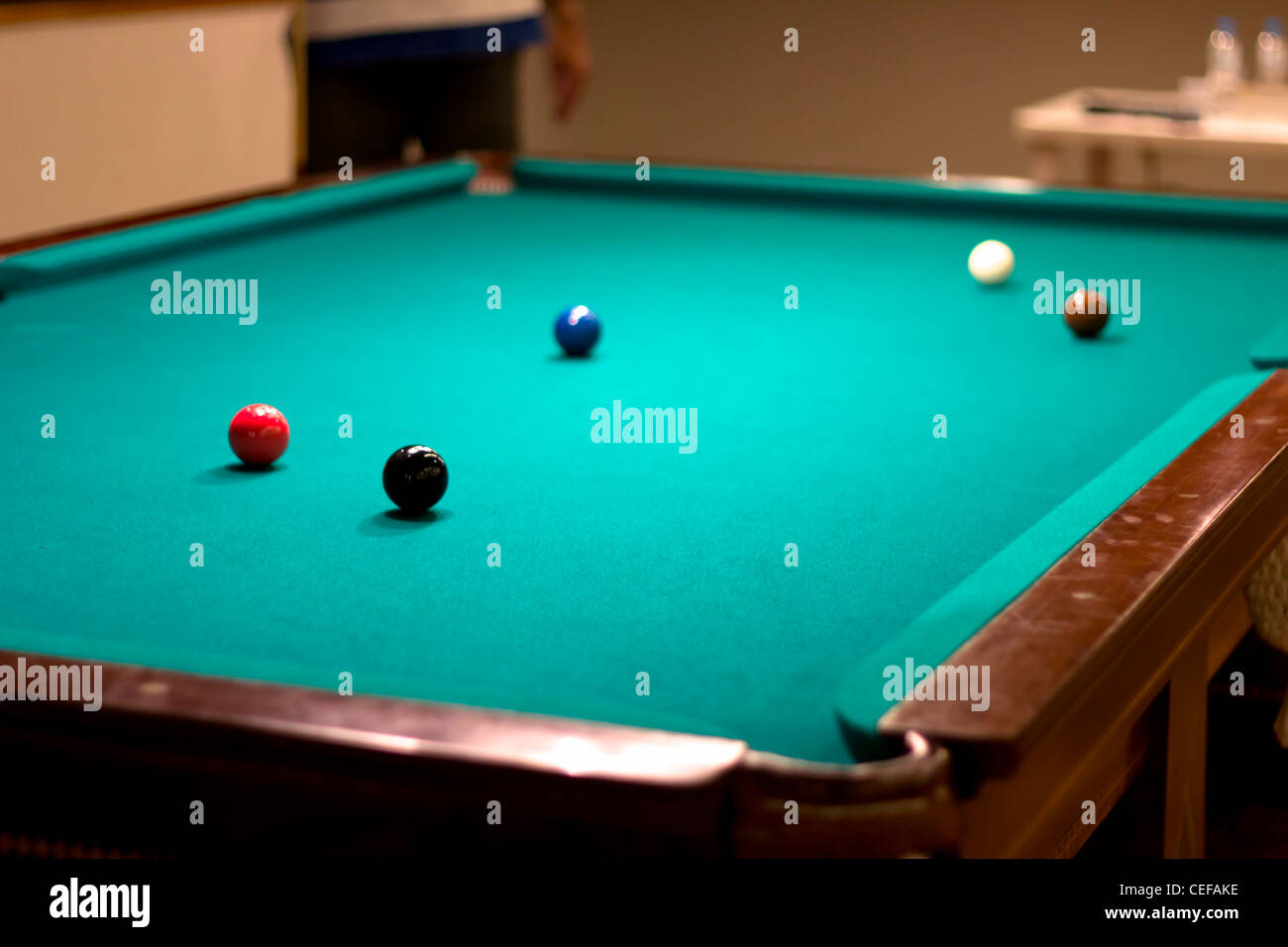 A pool table with several snooker balls - Stock Image