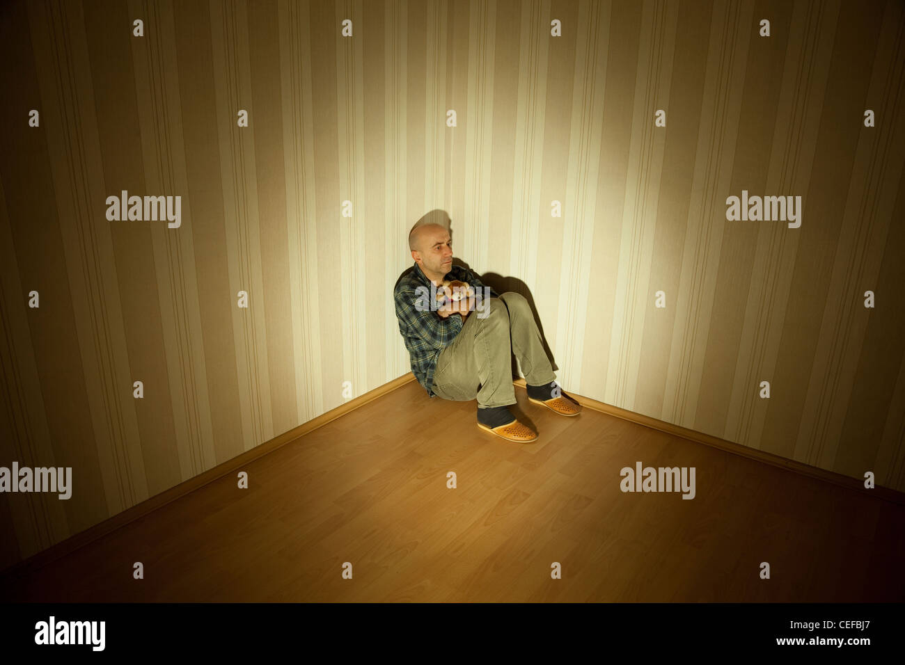lonely man in angle ill on depression - Stock Image