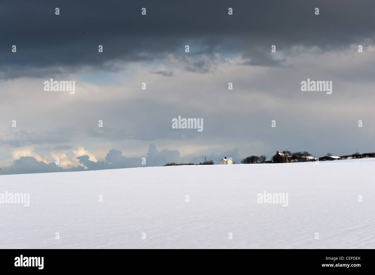 Snow fall over cottages; - Stock Image