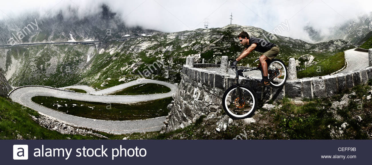 Mountain biker on Gotthard Pass - Stock Image