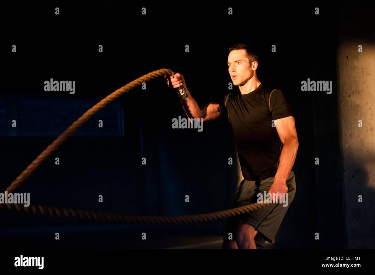 Athlete spinning jump ropes Stock Photo