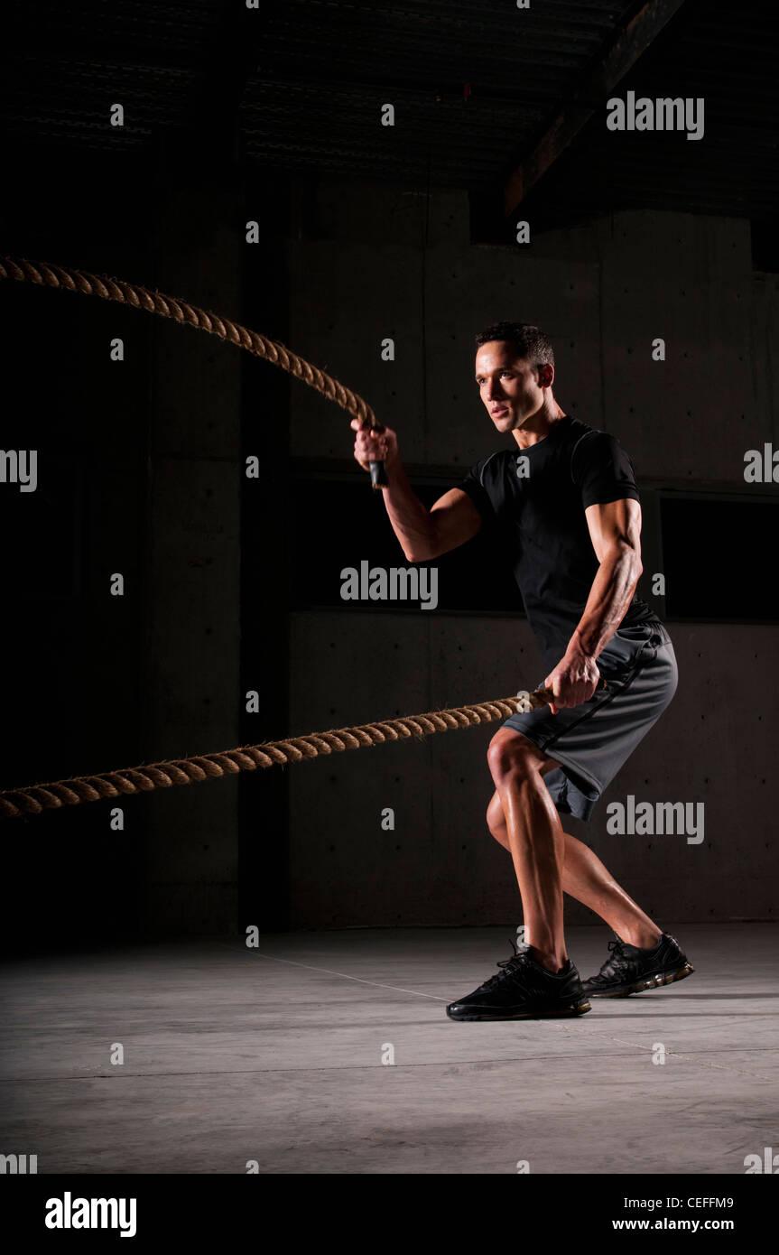 Athlete spinning jump ropes - Stock Image