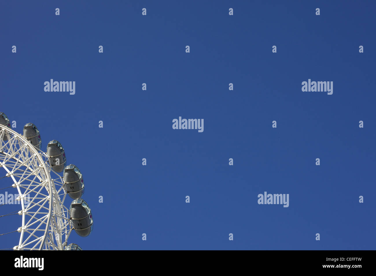 A portion of TheLondon Eye against  cloudless clear blue sky, - Stock Image