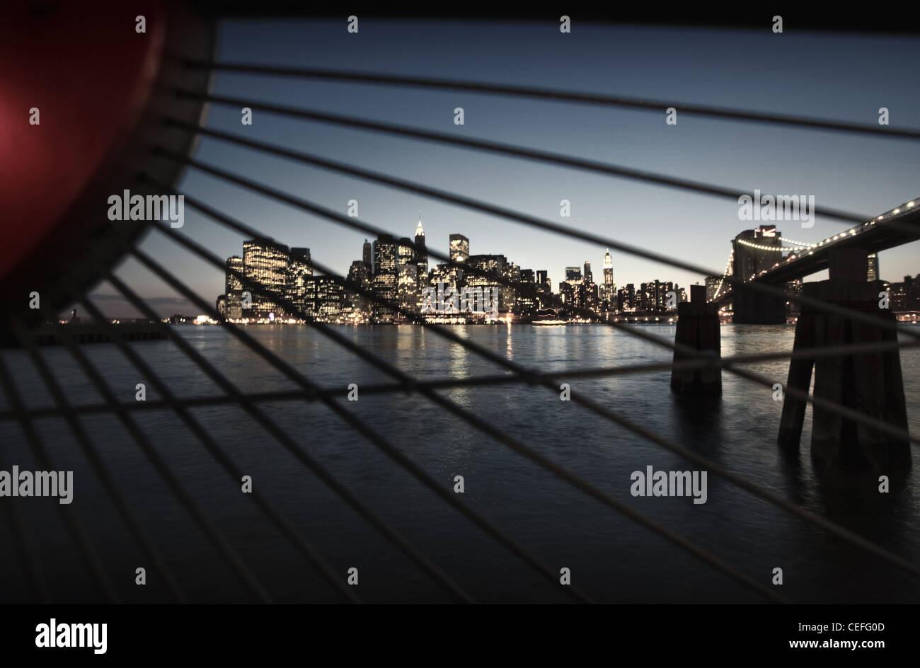 Manhattan skyline lit up at night - Stock Image