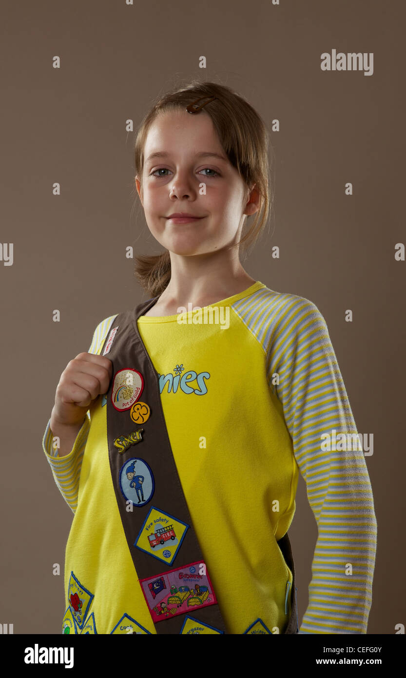 Portrait of a Brownie girl guide in studio - Stock Image