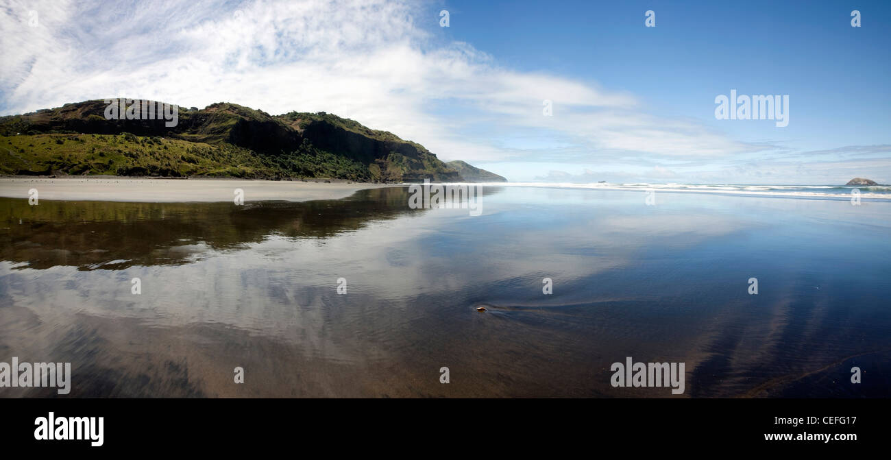 Sky and mountain reflected in water - Stock Image