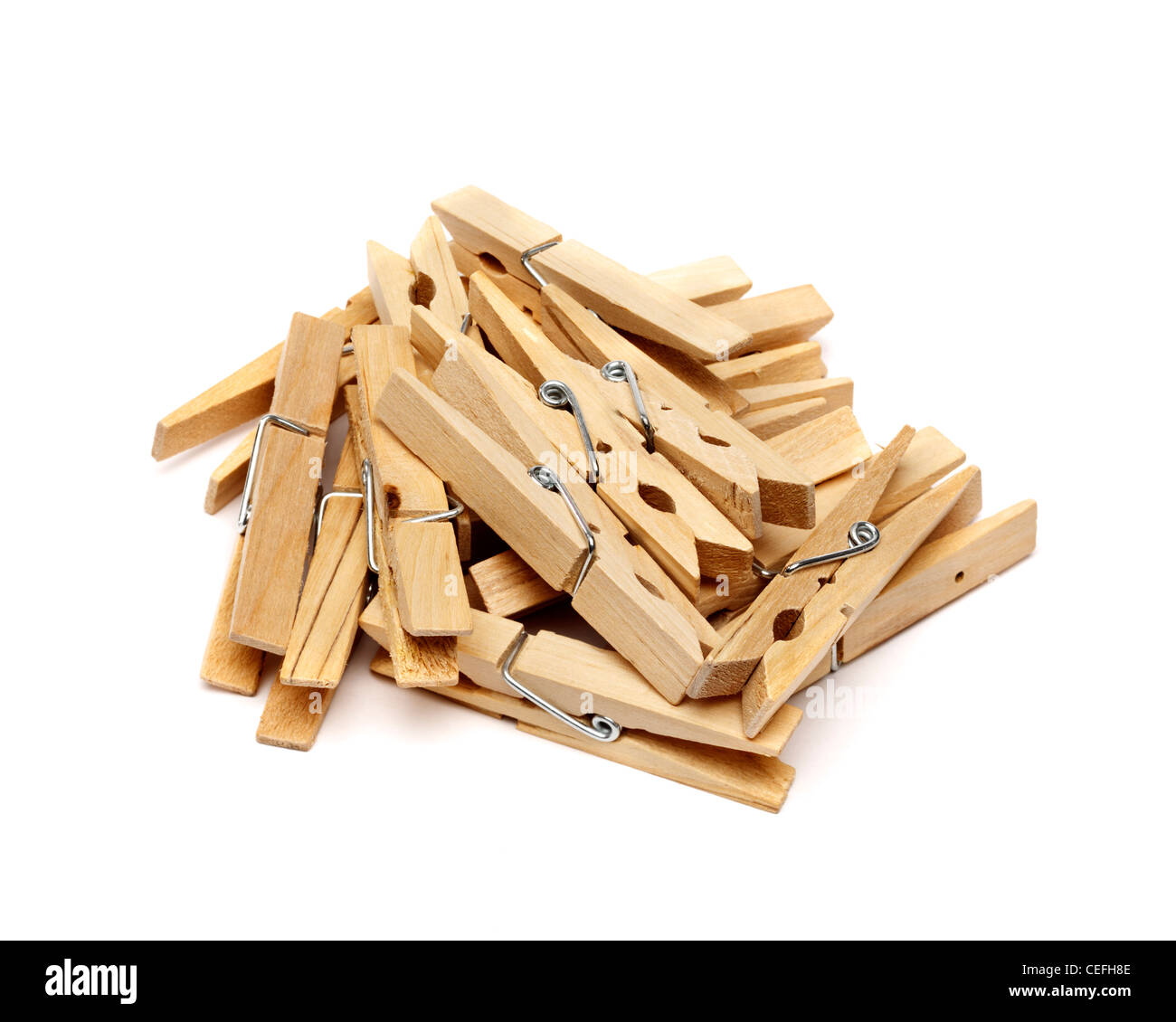 Wooden clothes peg pile on white background - Stock Image
