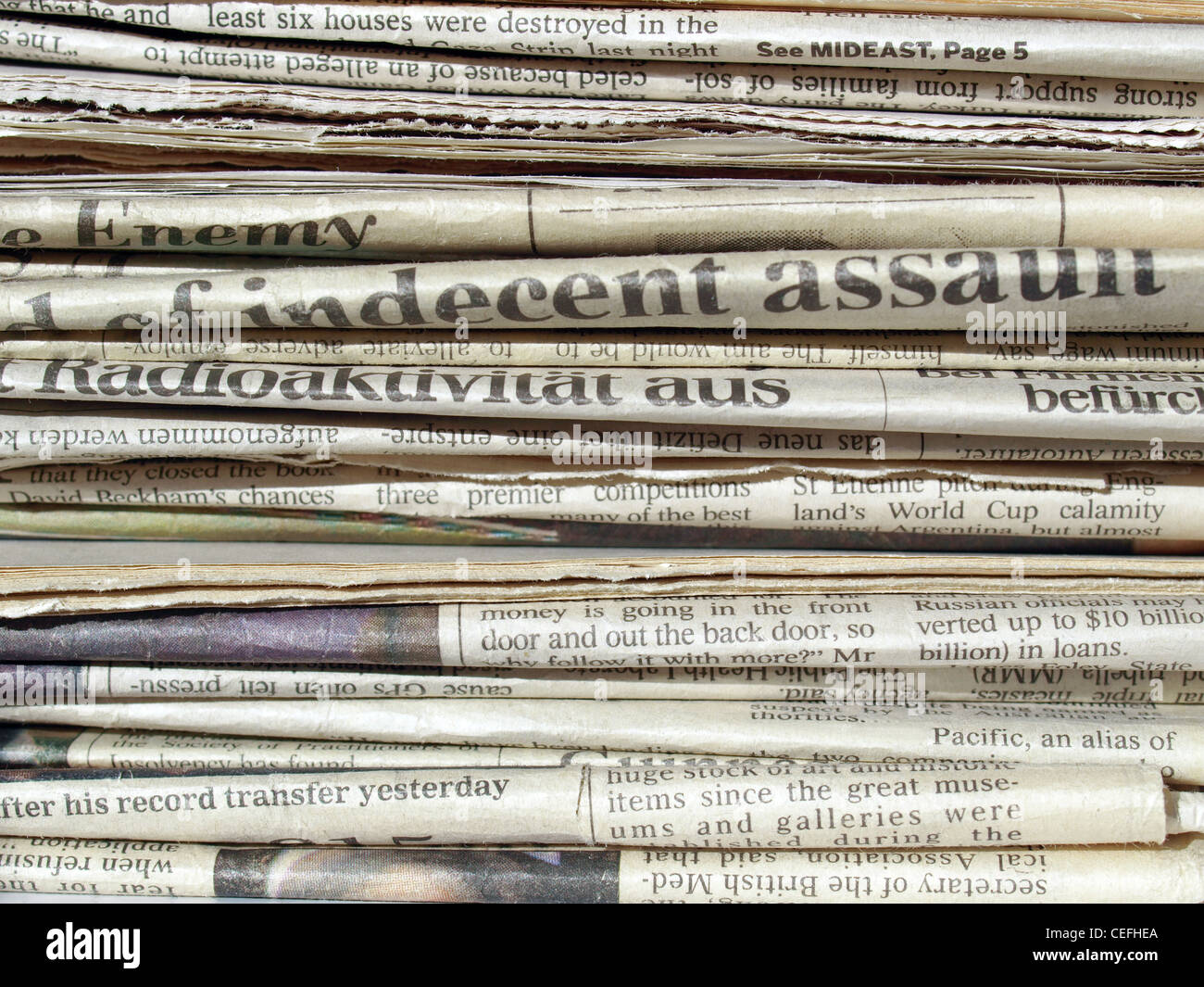 Detail of a pile of international newspapers - Stock Image