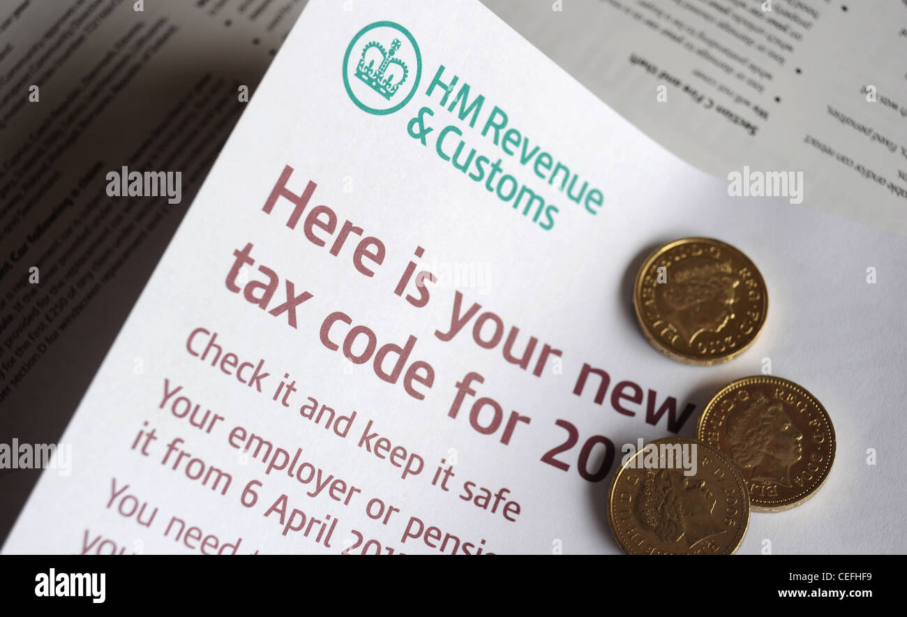 HM REVENUE AND CUSTOMS TAX CODE INFORMATION LEAFLET WITH BRITISH POUND COINS RE TAXATION WAGES INCOMES SALARY LIVING - Stock Image