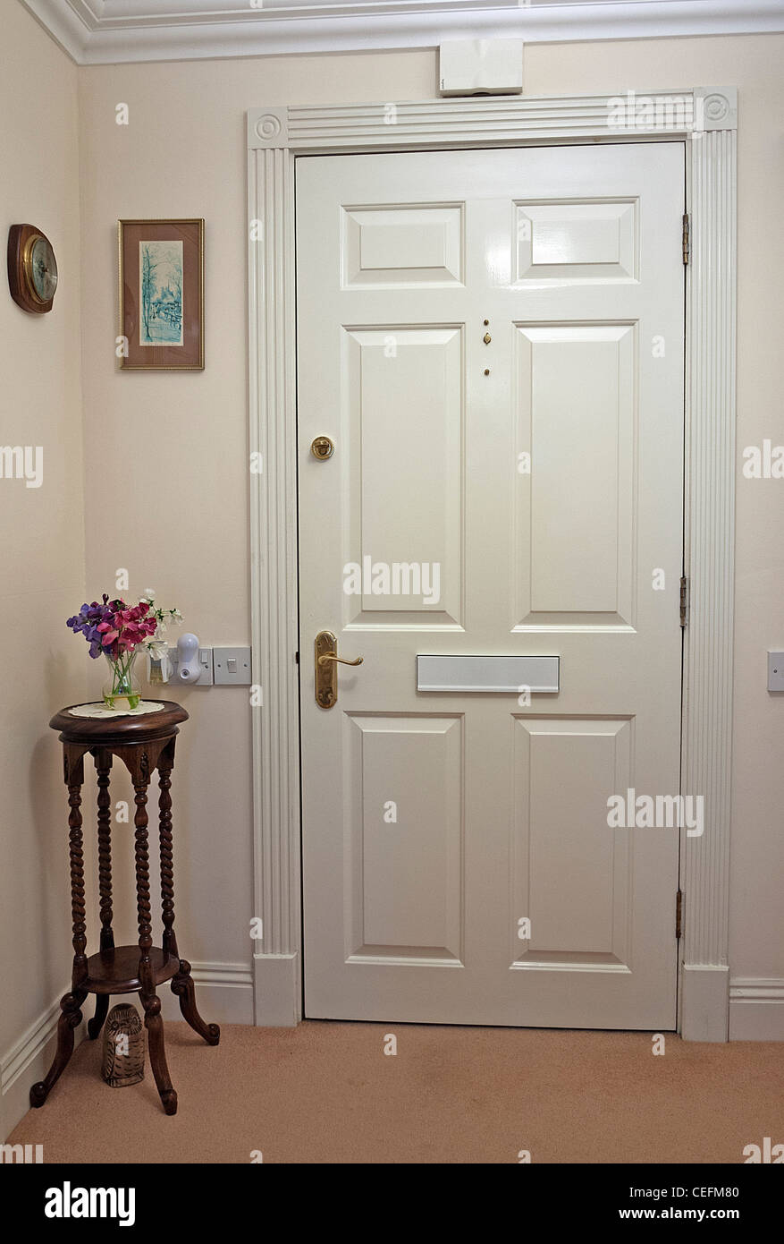 Apartment Entrance Door from inside a hallway with a side ...