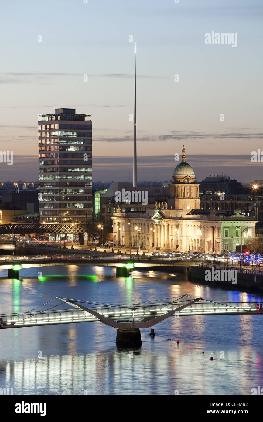 River Liffey, Dublin at dusk, looking west, with Custom House, Liberty Hall, Sean O'Casey Bridge and the Spire - Stock Image