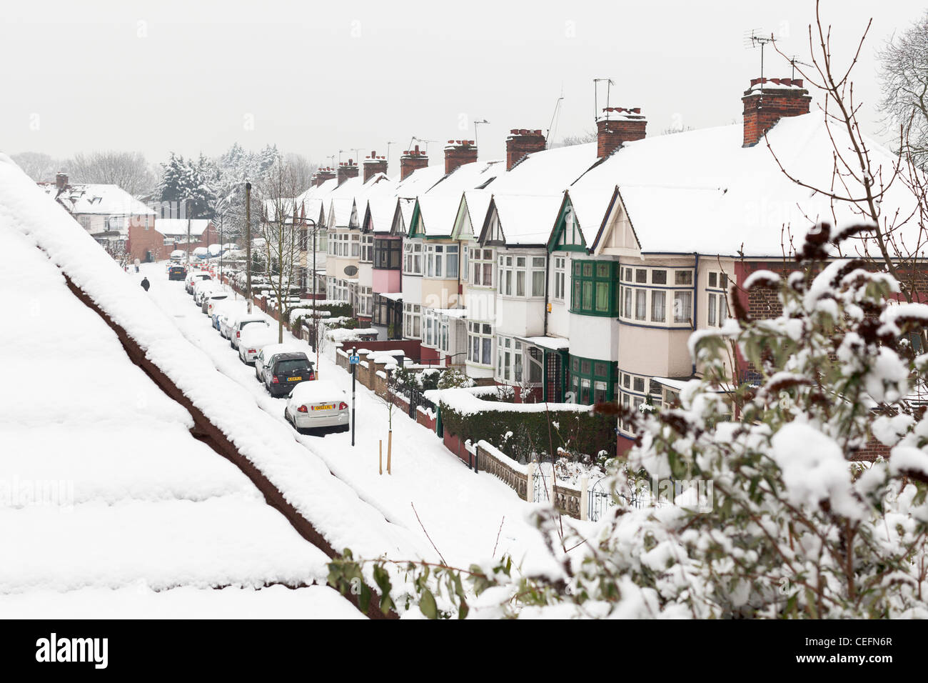 A snowy winter day in a suburban London street, England - Stock Image