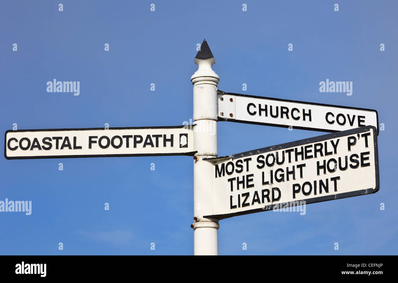 Lizard Cornwall England UK. Traditinal direction signpost to coastal path and most southerly point of Britain against - Stock Image