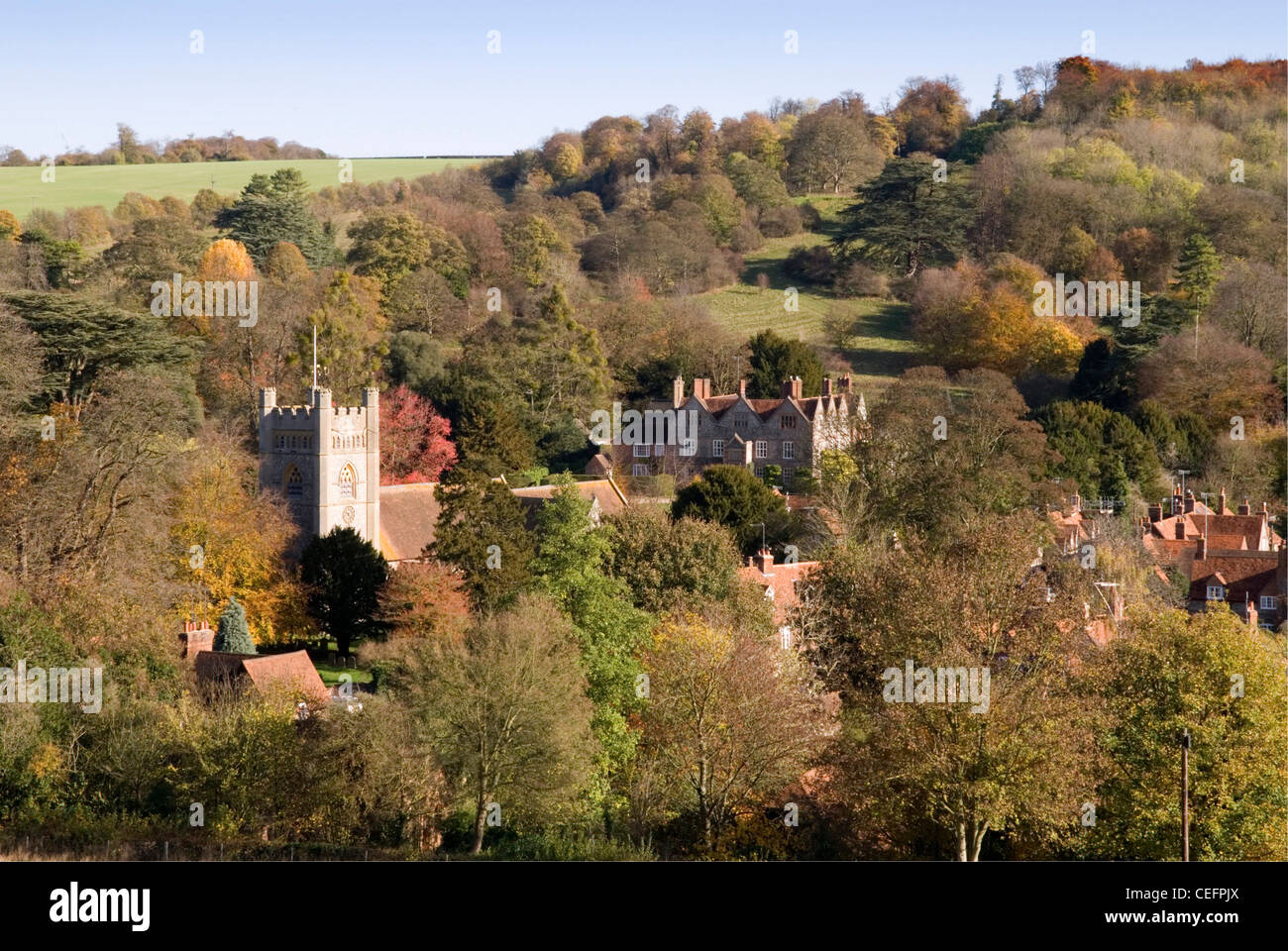 Chiltern Hills - Hambleden village - seen in context with its surroundings - wooded hillsides - autumn colours - Stock Image