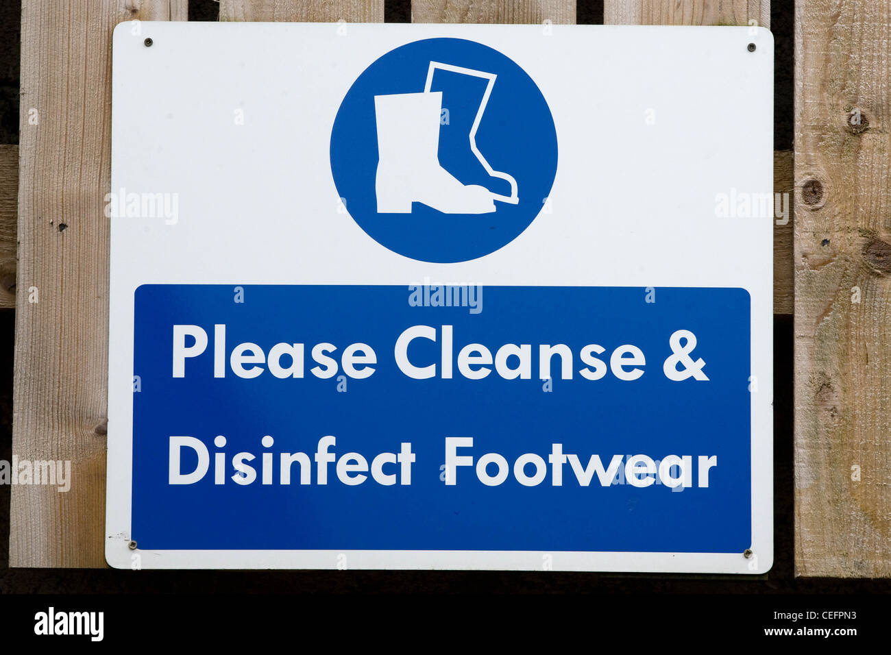 Please Cleanse & Disinfect Footwear Sign - Stock Image