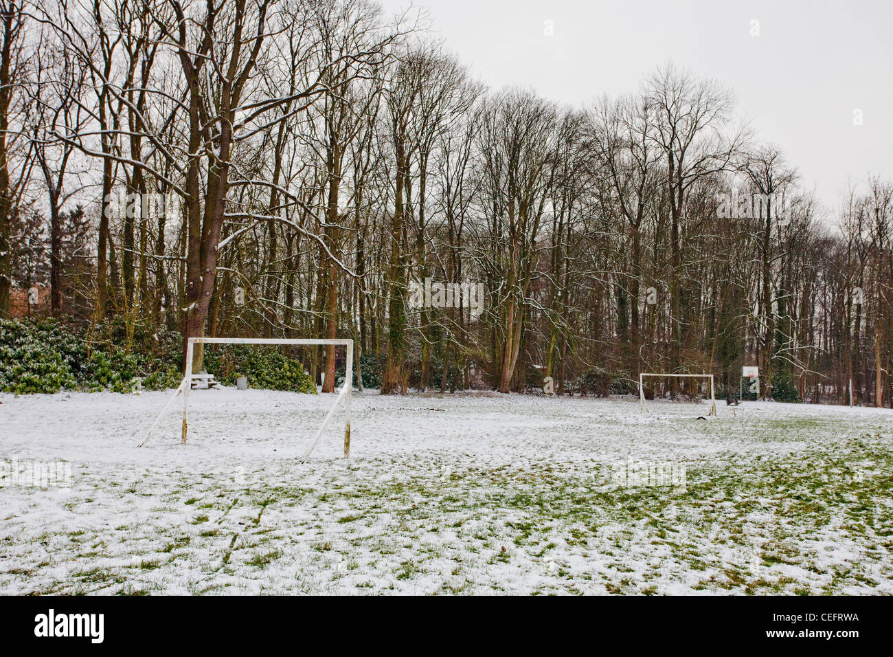 Empty snow covered football pitch - Stock Image