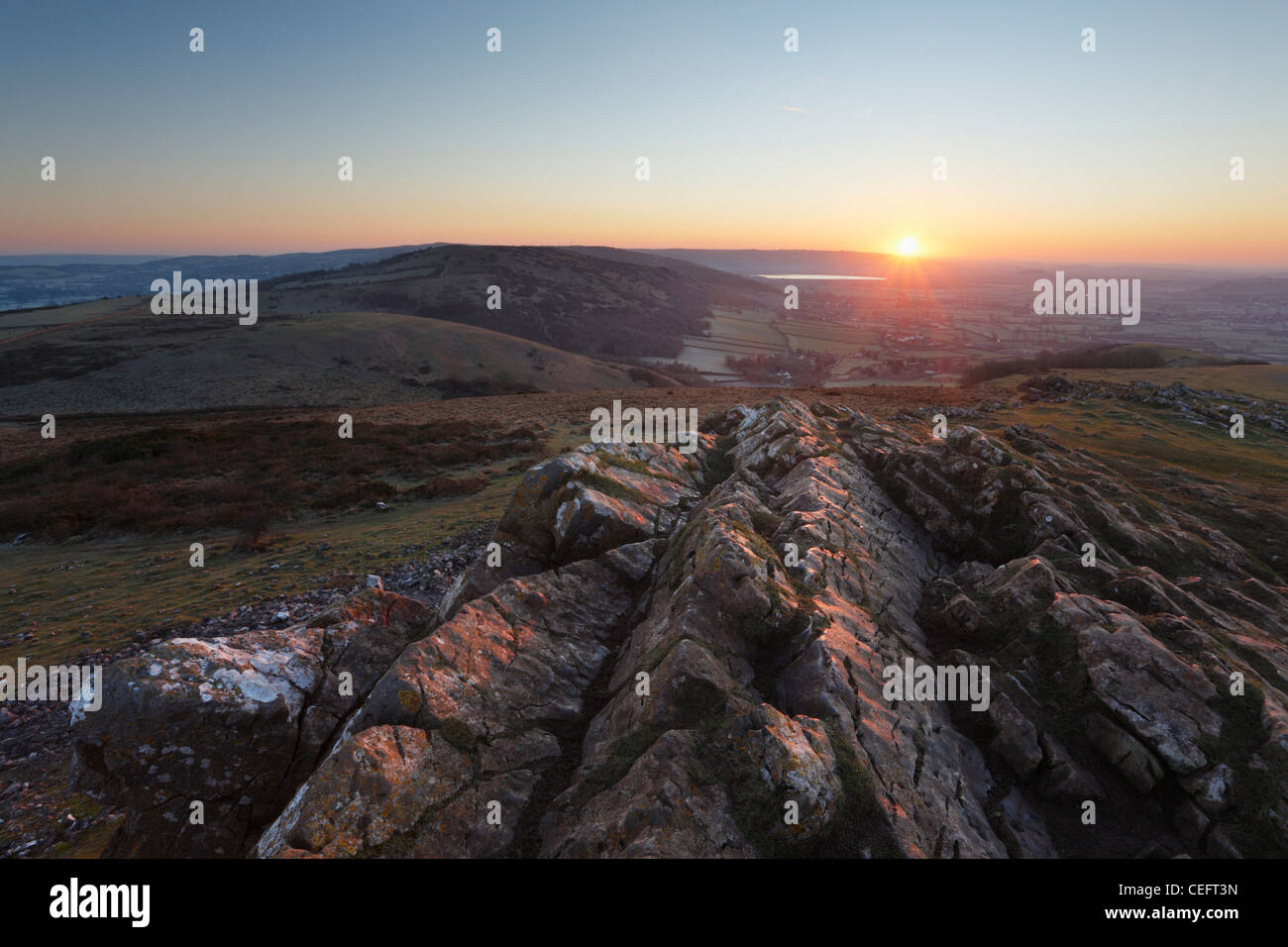 Sunrise over the Mendip Hills from Crook Peak. Somerset. England. UK. - Stock Image