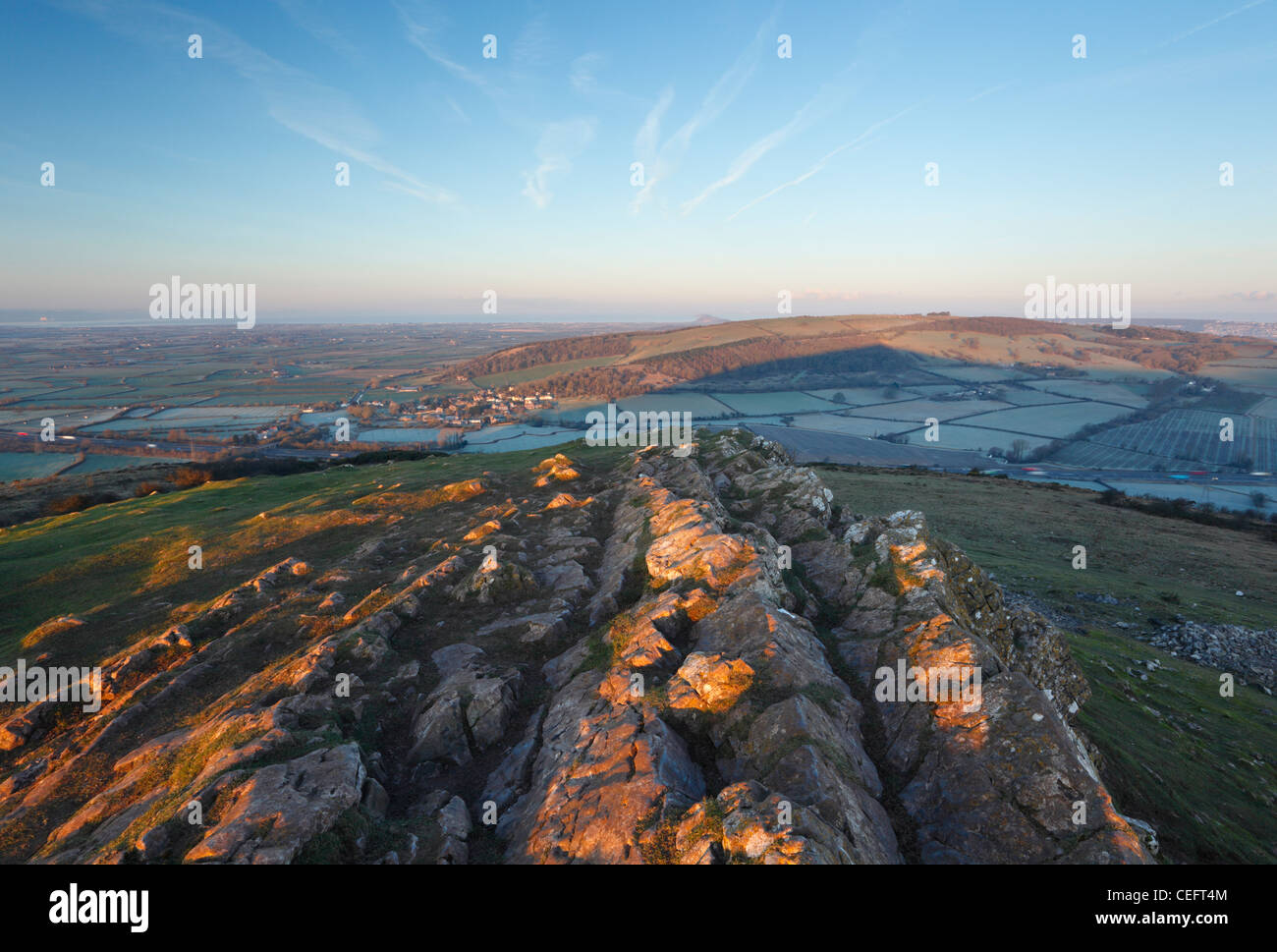 View from the summit of Crook Peak towards Bleadon Hill, Brean Down and the Bristol Channel. Somerset. England. - Stock Image