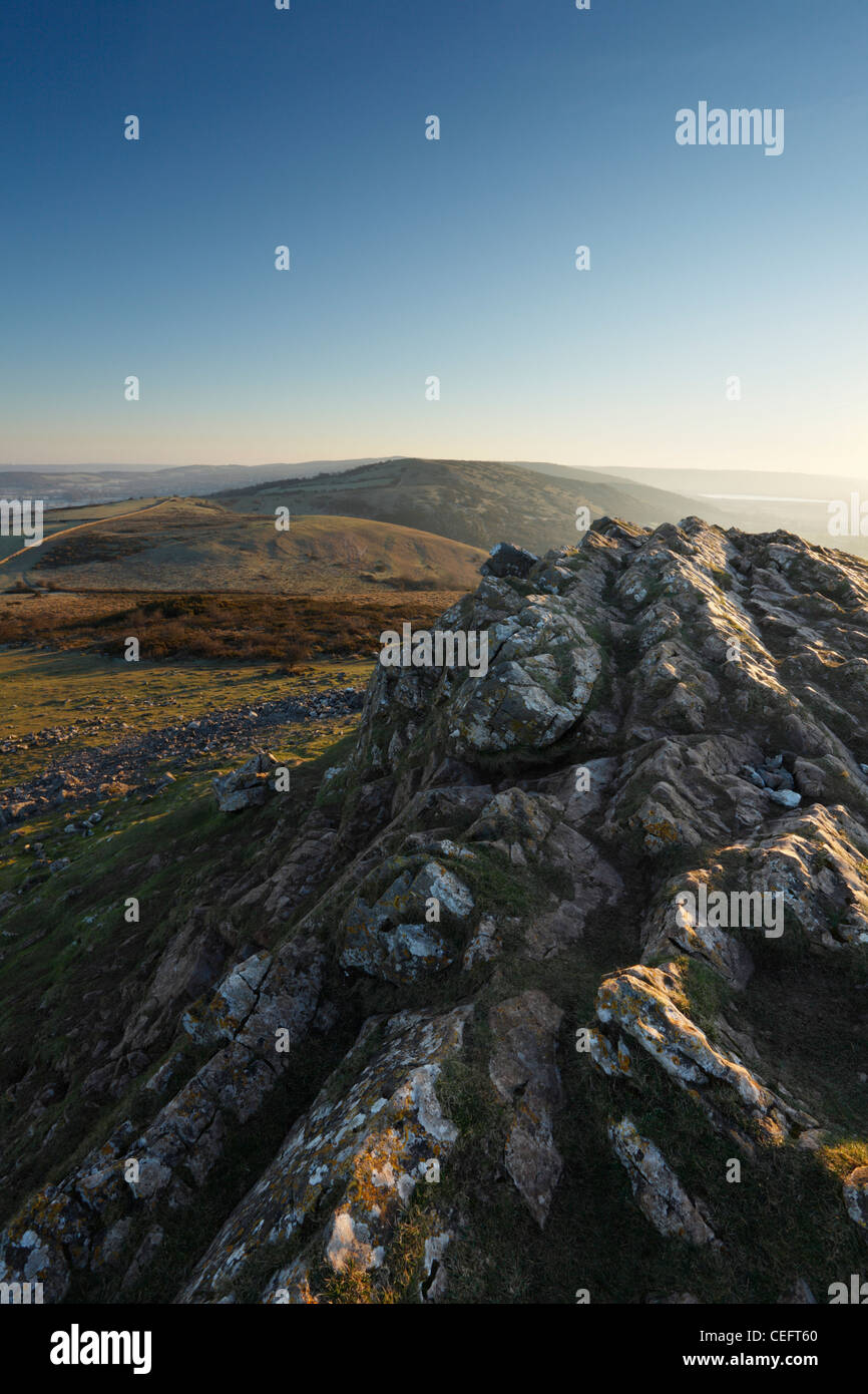 View from the summit of Crook Peak towards Wavering Down. The Mendips, Somerset, England, UK. - Stock Image