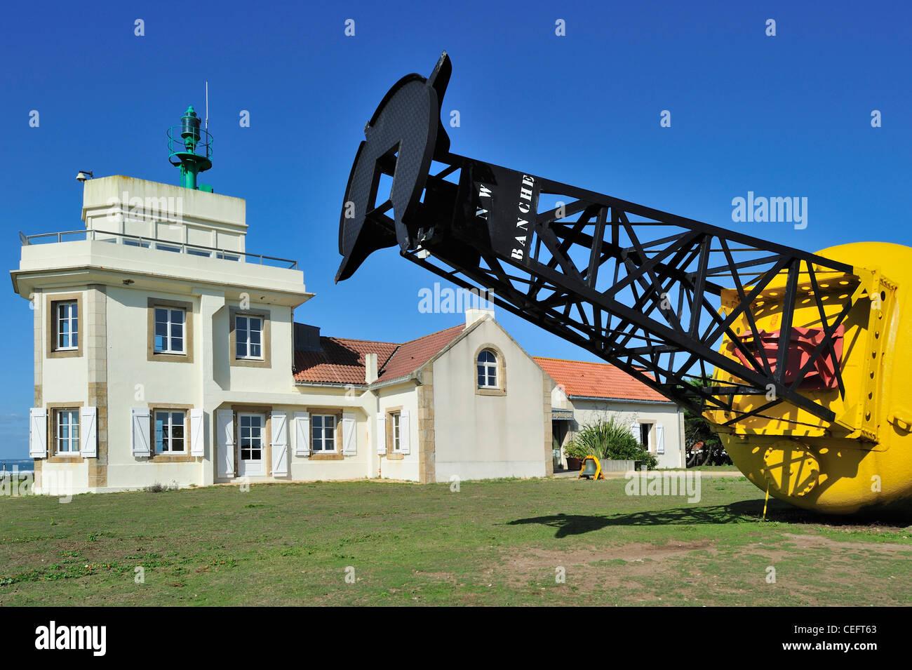 Semaphore / Lighthouse and buoy at the Pointe Saint-Gildas / Saint Gildas Point, Loire-Atlantique, France Stock Photo