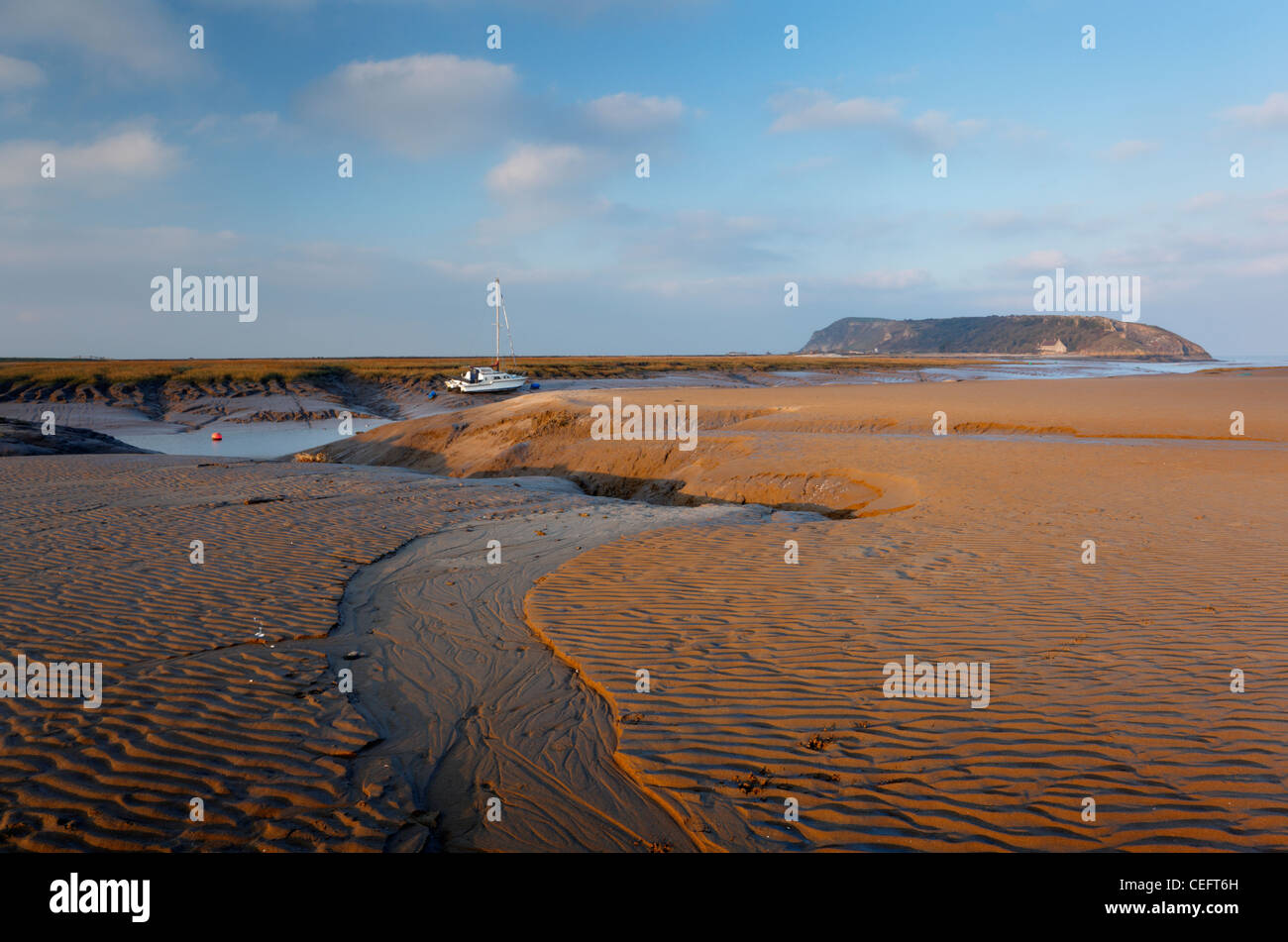 Beach at Uphill and River Axe Estuary with Brean Down in the Distance. Weston-super-Mare, Somerset, England, UK. - Stock Image