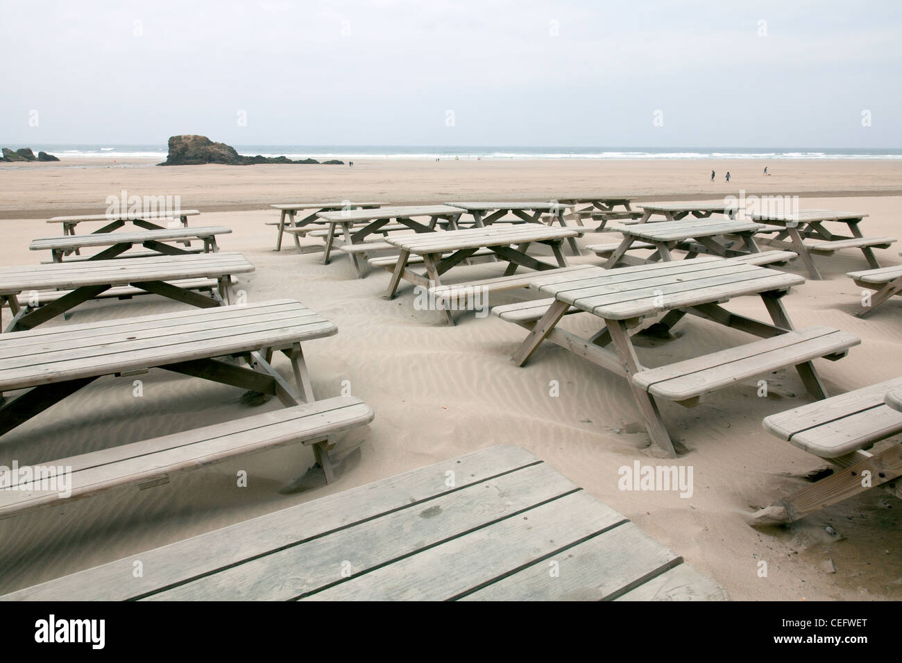 Perranporth, Cornwall, England the tables at The Watering Hole Bar, Pub on the beach looking out  to sea coast - Stock Image