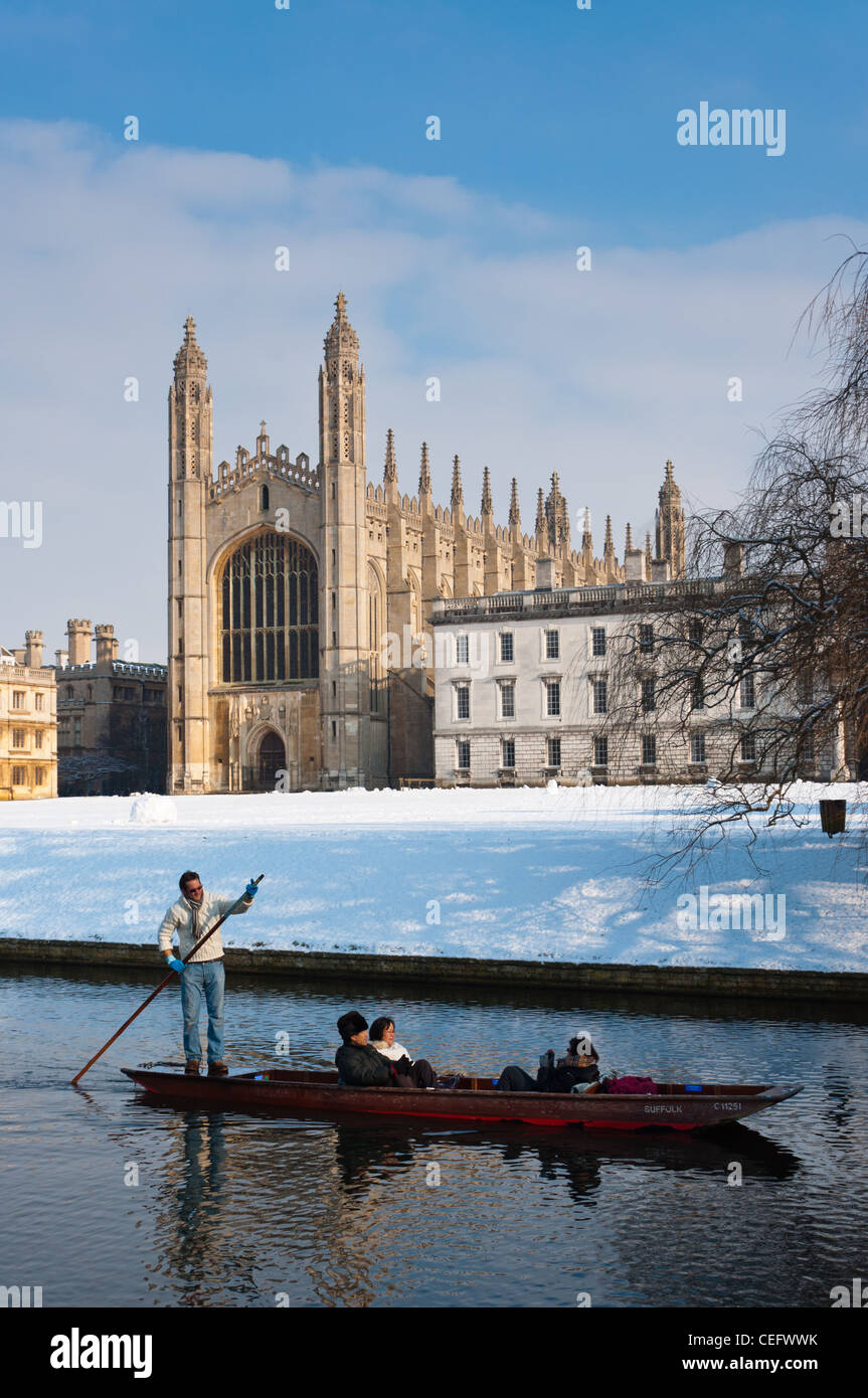 Punting along river Cam in winter snow with Kings College Chapel to the rear. Cambridge, England. - Stock Image
