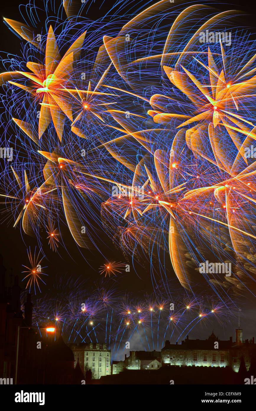 Spectacular fireworks over Edinburgh Castle, Scotland celebrating Hogmanay (that is New Year) - Stock Image