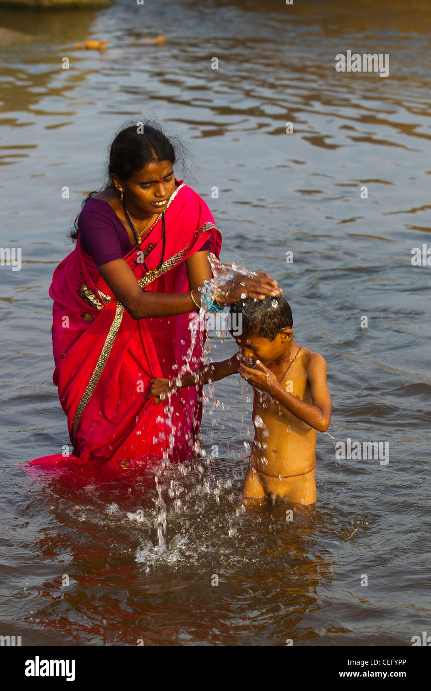 Indian Mother Bathing His Son On The Waters Of Tungabhadra -8137