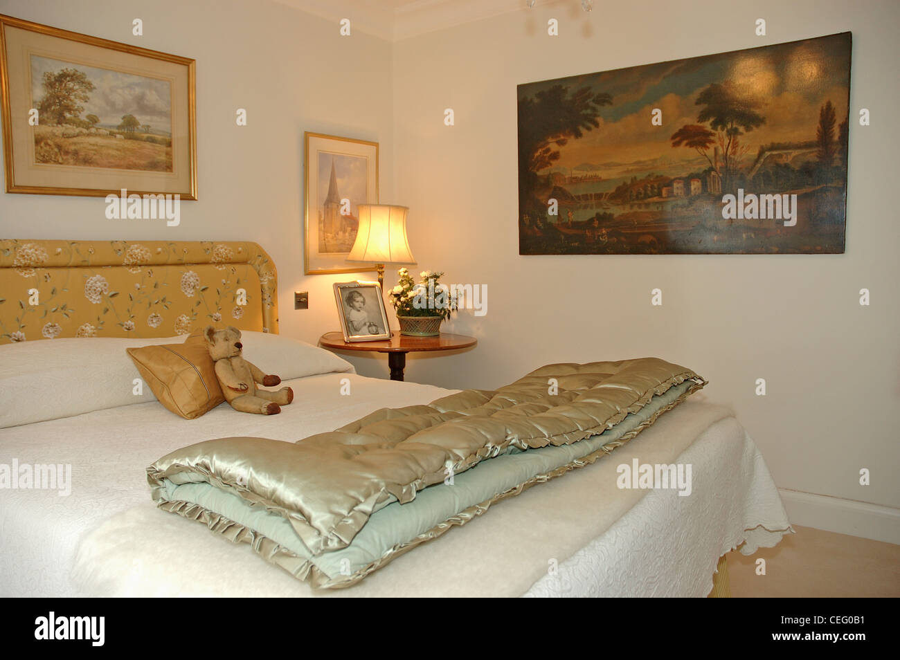 Folded Vintage Silk Eiderdown On Bed With Upholstered Headboard In Stock Photo Alamy